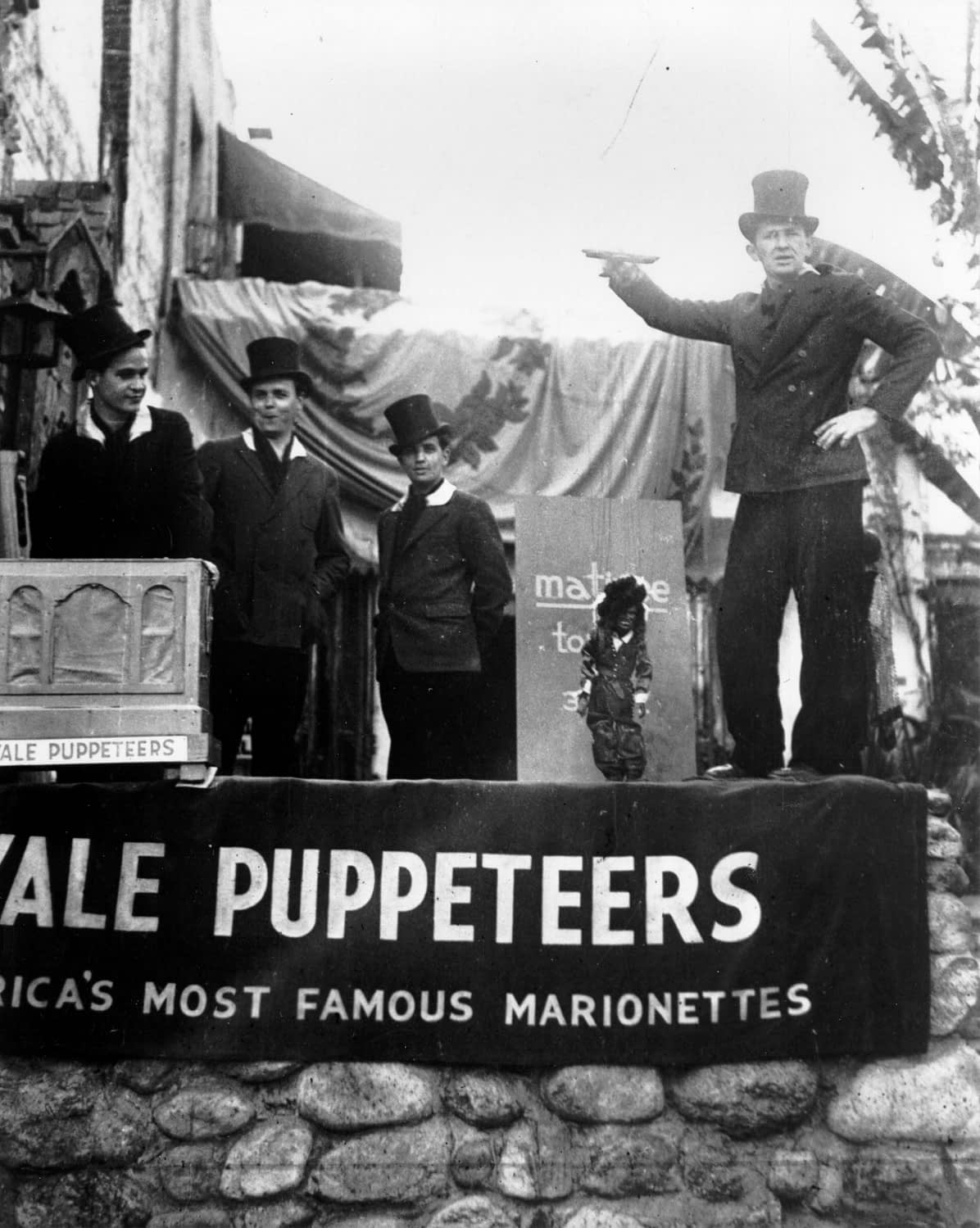 "The Yale Puppeteers and Beverly Brown attracting customers with ""Douglas Fairbanks"" outside of their Olvera Street theater, ca. 1930."