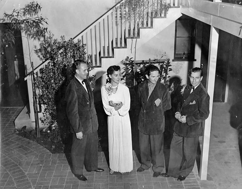 Forman Brown, Dorothy Neumann, Harry Burnett, and Roddy Brandon stand in the courtyard of the Turnabout on opening night.